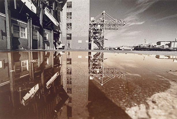An image of Reflected crane