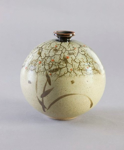 An image of Round pot with tenmoku and ash glazes decorated with design of grass and red dots by Shiga Shigeo