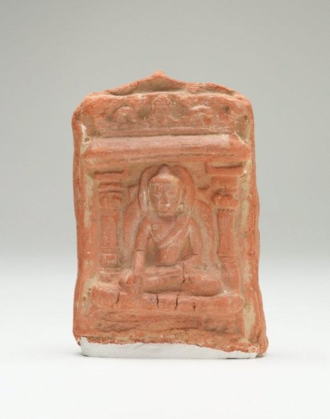 An image of Brick decorated with seated Buddha by