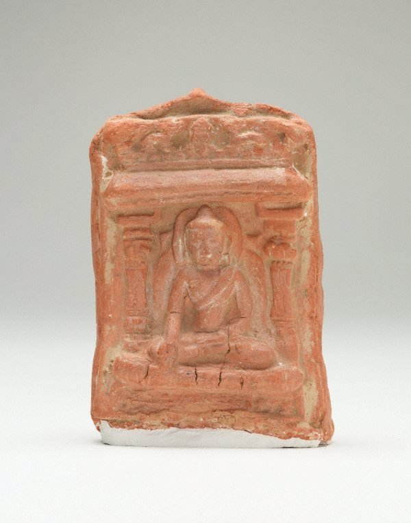 An image of Brick decorated with seated Buddha