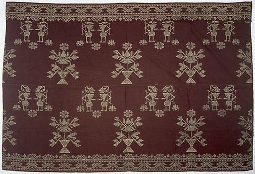 An image of skirtcloth or hanging with 'wayang' figures by
