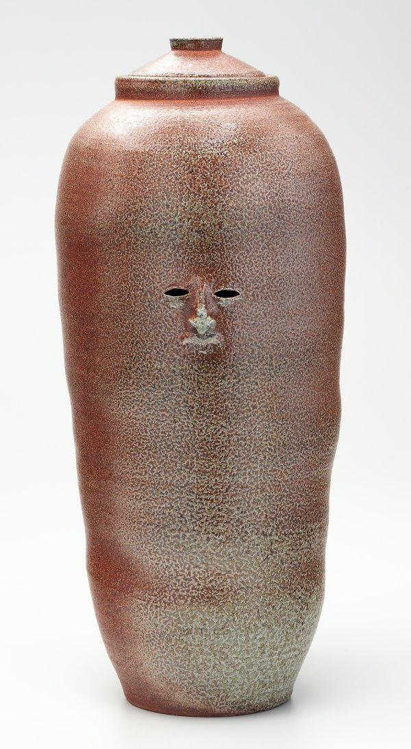 An image of Tall brown urn
