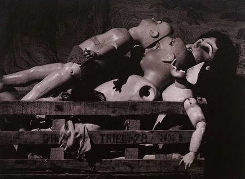 An image of (Dolls in box) by Lewis Morley