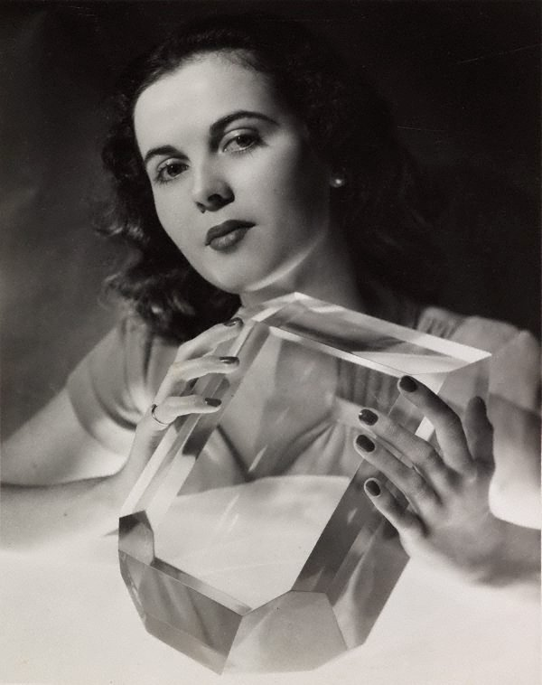 June Prior photographed with a perspex scaled model of a perfect sugar crystal, (1948) by John Lee Studio