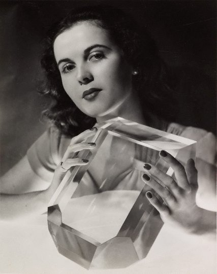 AGNSW collection John Lee Studio June Prior photographed with a perspex scaled model of a perfect sugar crystal 1948