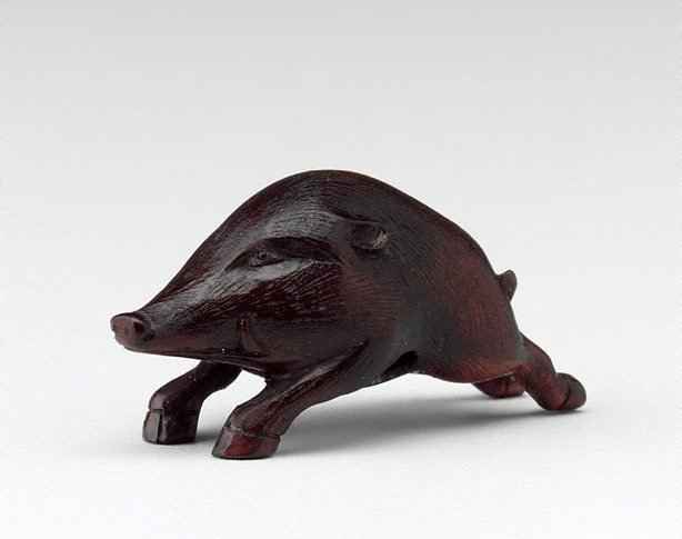 An image of Netsuke in the form of a running boar