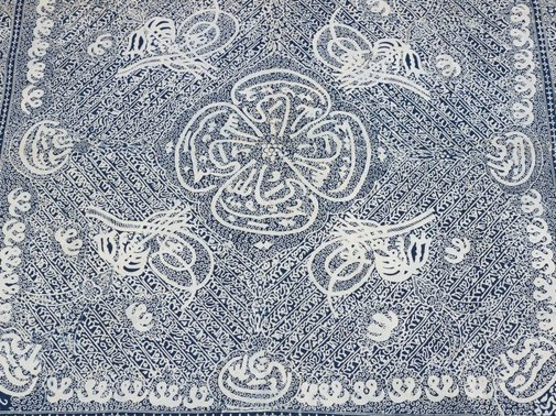 An image of Head cloth with stylised Islamic calligraphy design by