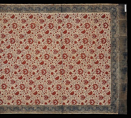 An image of Batik cloth with traditional Jambi stamped floral design by