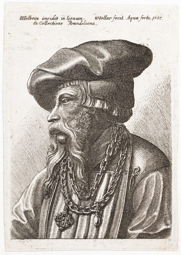 An image of Bearded man wearing a linked chain