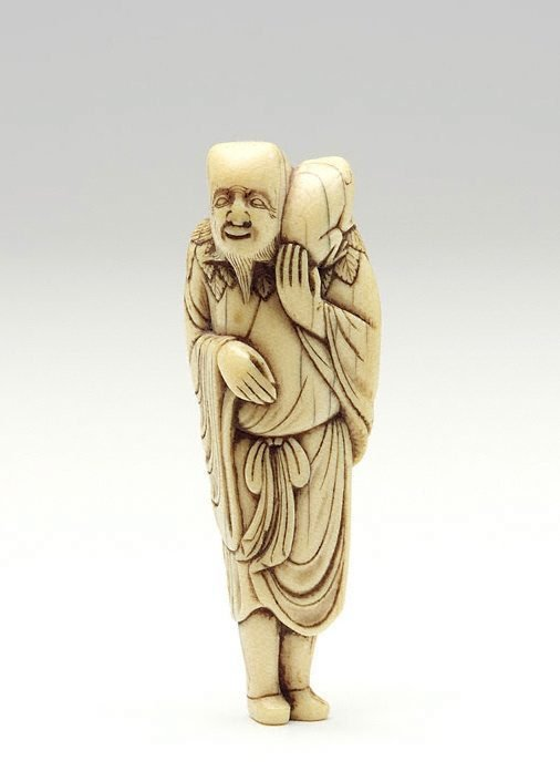 An image of Netsuke in the form of Gama 'sennin' with a toad