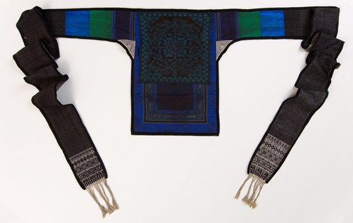 An image of Dark blue and purple embroidered baby carrier complete with original long straps by Miao people