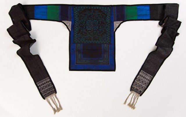 An image of Dark blue and purple embroidered baby carrier complete with original long straps