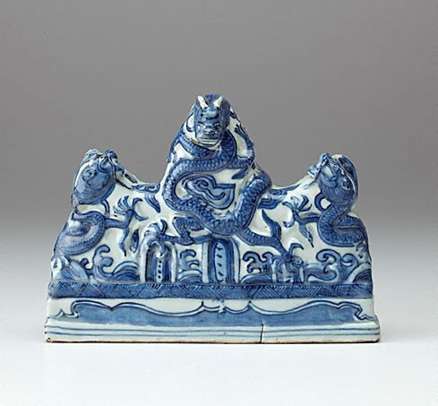 An image of Brush rest moulded in the form of three dragons by Jingdezhen ware