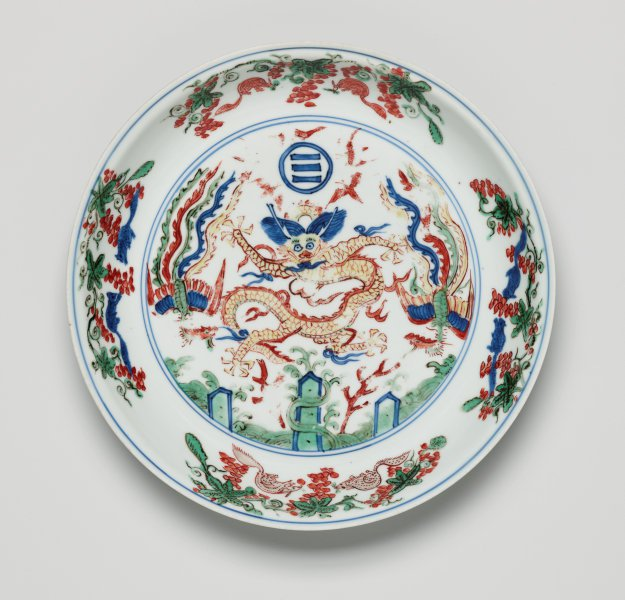 An image of 'Wucai' dish decorated with dragon and two phoenixes above the Immortal Isles in the Eastern sea