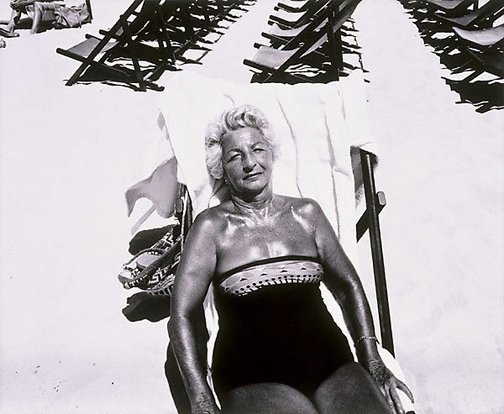 An image of Woman in beach chair by Jon Lewis