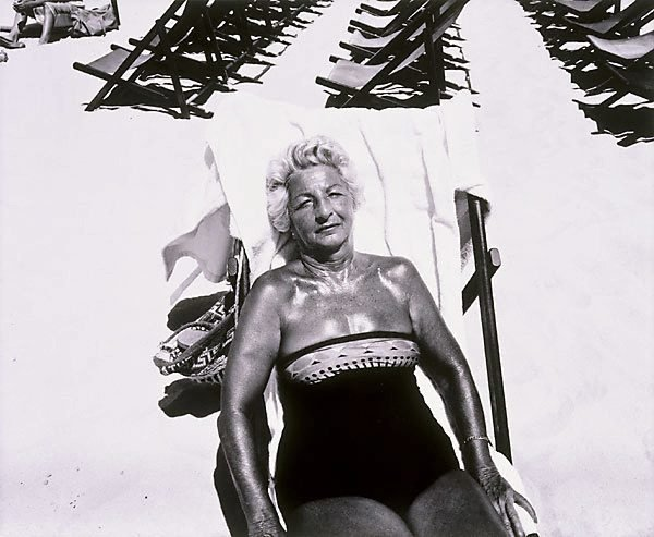 An image of Woman in beach chair