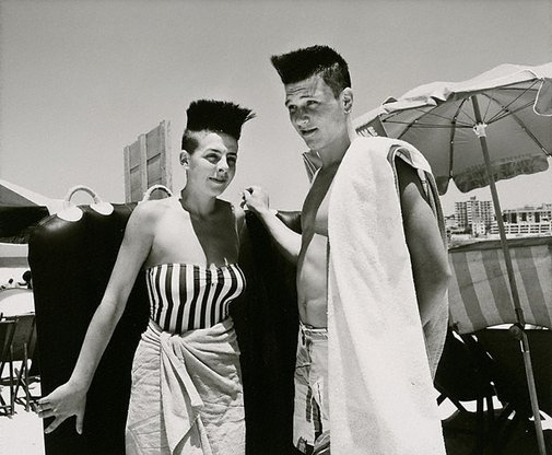 An image of Couple with punk hairstyle by Jon Lewis