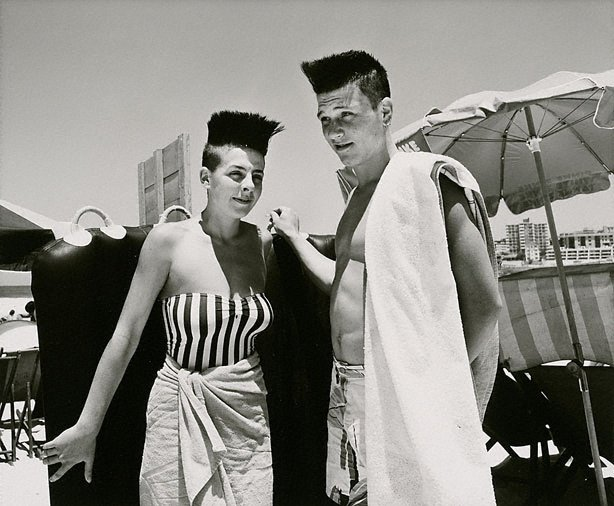 An image of Couple with punk hairstyle