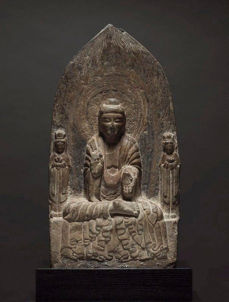 An image of Buddhist stele with Buddha and two Bodhisattvas by