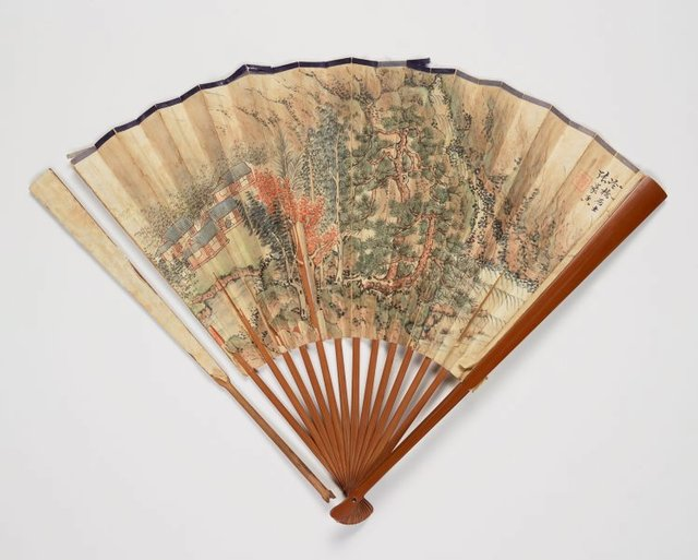 An image of A folding fan with a landscape painting 'Sound of Pines and the flowing spring' after Wang Hui (1632-1717) and a calligraphy in seal script