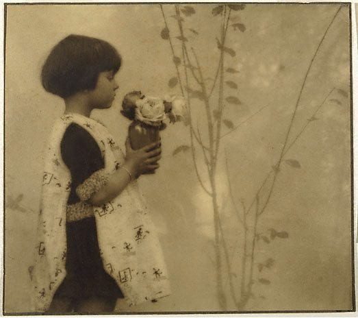 An image of Child and roses