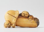 Alternate image of Netsuke in the form of a mushroom with 'okame' leaning against it and 'oni' crouching under it by