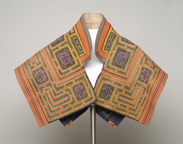 An image of Yellow embroidered cape