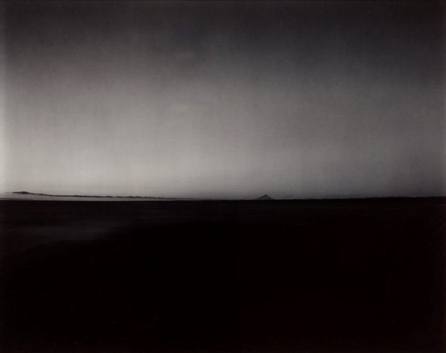 An image of A distant view of Taranaki from the mouth of the Wanganui river, at dusk, 3 February 1986
