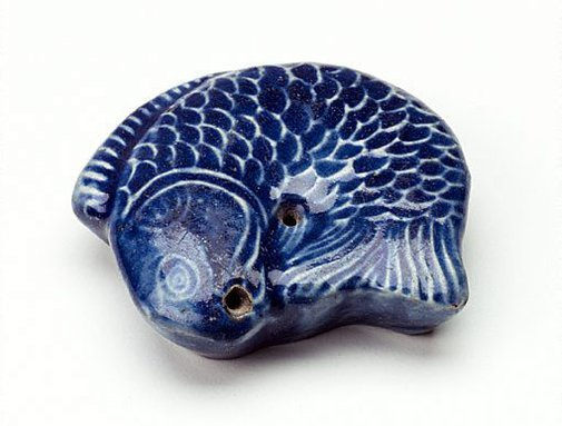 An image of Water dropper moulded in the shape of a fish by