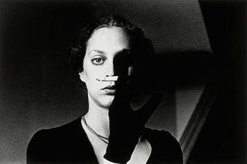 An image of Untitled (woman with cigarette) by Ralph Gibson