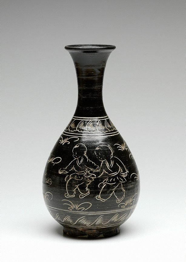 An image of Cizhou ware vase with incised design of children playing amidst grasses
