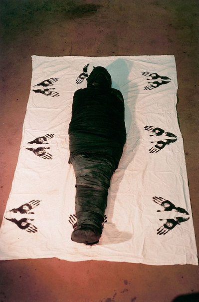 An image of Colour photograph documenting earth / body work with cloth and paint Iowa City (outskirts) by Ana Mendieta