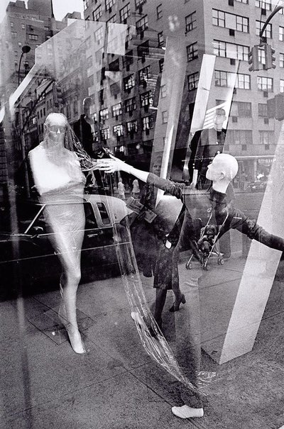 An image of Store window with reflections, New York by David Moore
