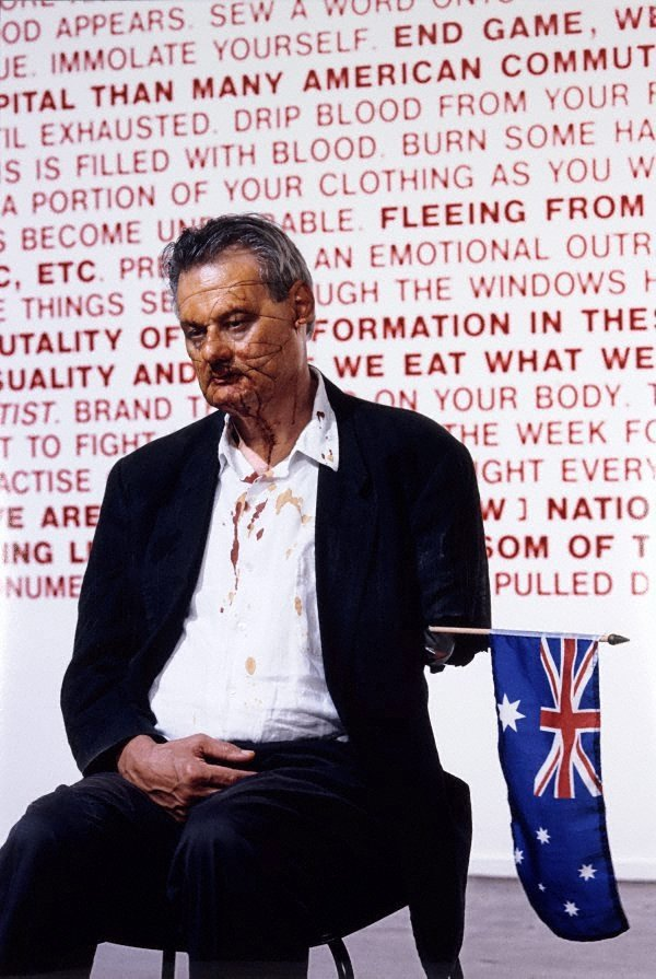 An image of a) Aussie, Aussie, Aussie, Oi, Oi, Oi [UnAustralian], performance, Artspace, May 2 - May 3, 2003 b) UnAustralian, performance, Artspace, May 2 - May 3, 2003