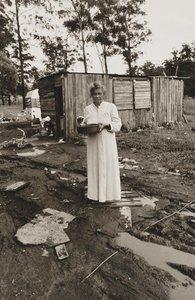 Woman standing near electric power cord in water, Burnt Bridge, (1988, printed 2008) by Mervyn Bishop