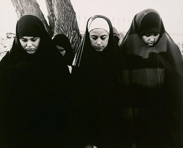 An image of Three girls praying at the Preston Mosque (Lebanese Sunni)