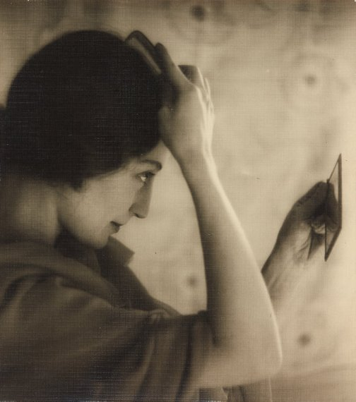An image of Untitled (Girl brushing her hair) by A.W. Gale