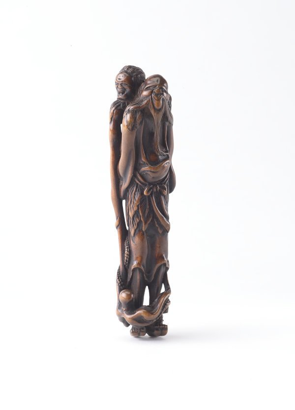 An image of Netsuke in the form of 'Ashinaga' ('the long legs') carrying 'tenaga' ('the long arms') who is holding an octopus