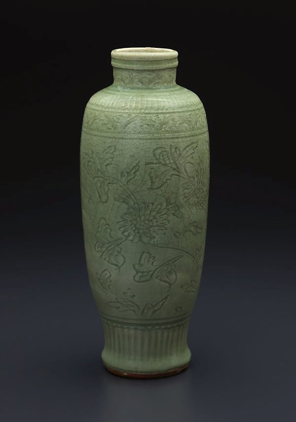 An image of Vase of slender baluster shape with carved floral design