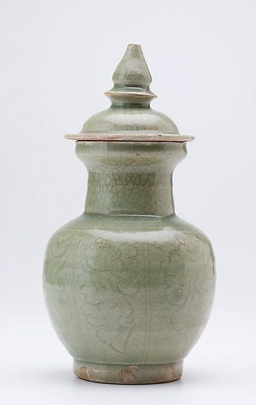 An image of Covered jar with carved decoration