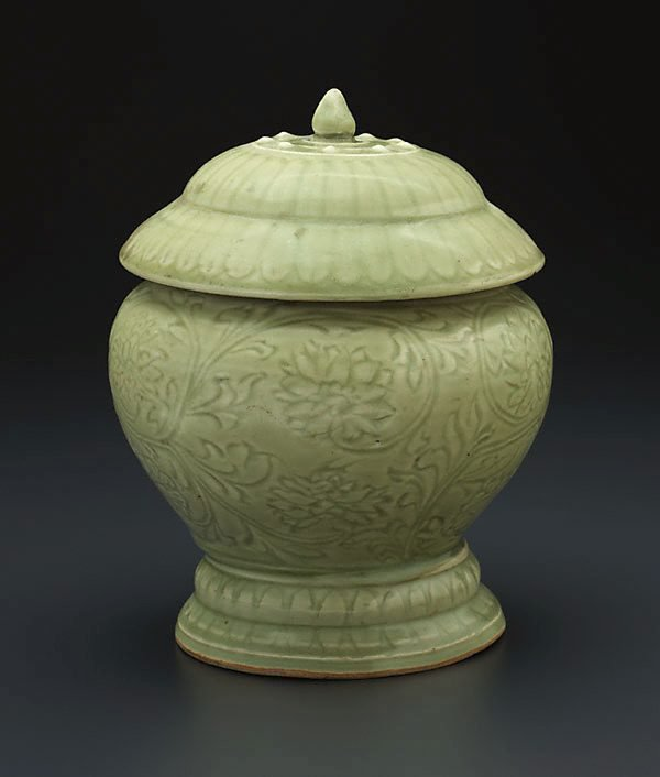 An image of Globular covered jar with carved lotus design
