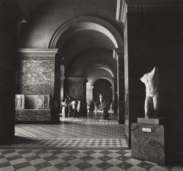 An image of Untitled (interior of the Louvre with a view towards Venus de Milo)