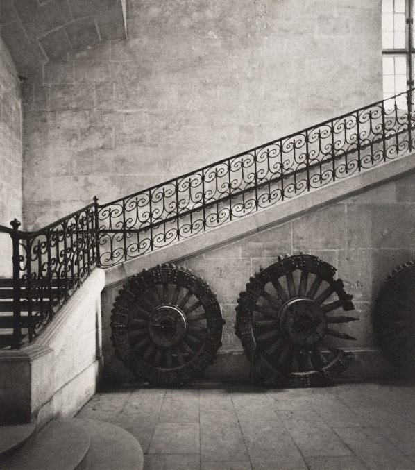 An image of Untitled (interior staircase and cart wheels)