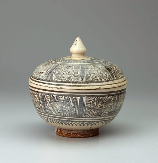 An image of A large deep covered bowl with large knop finial, painted with panels of feathery foliage by Sukothai ware