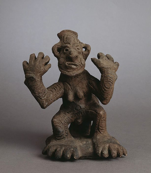 An image of Yaul male figure with hands raised