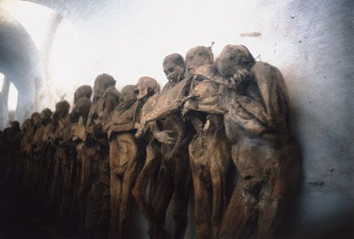 An image of Mummified bodies, near Mexico City by Albert Tucker