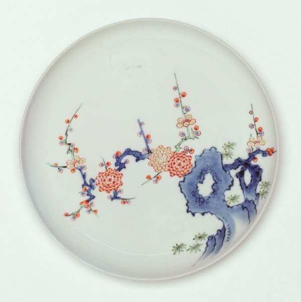 An image of Dish with design of rock and plum tree