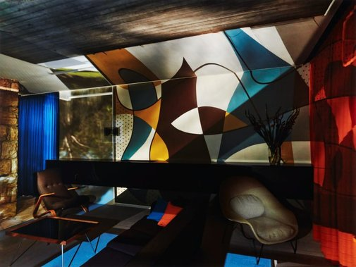 An image of Living room Rose Seidler House with exterior mural by Robyn Stacey