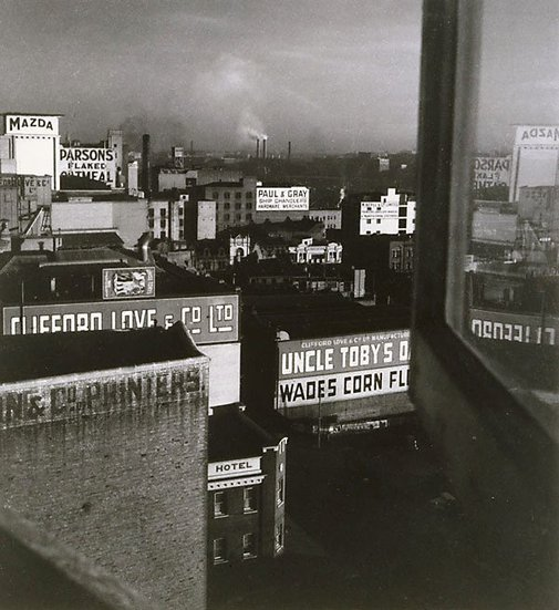 An image of City rooftops by Olive Cotton
