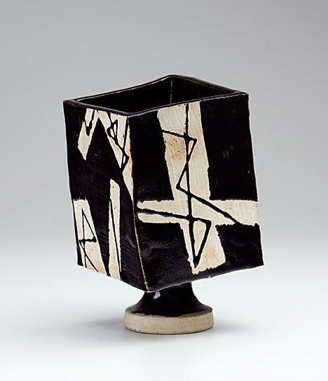 An image of Black glaze square jar